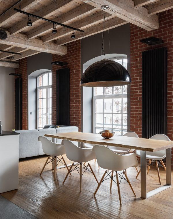 Apartment with industrial brick wall, wooden ceiling and dining table; Shutterstock ID 1410445010; PO: 575087551; Client: 9b556fe5-6314-453b-8028-861eb6f7a0e9