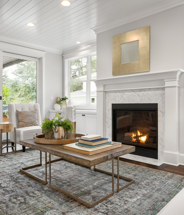 Beautiful white living room in new luxury home with white interior. Has fire in fireplace ; Shutterstock ID 1339847969; PO: 575088611; Client: 9b556fe5-6314-453b-8028-861eb6f7a0e9